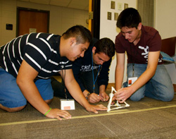 Students test their catapult at a Society of Hispanic Professional Engineers Noche de Ciencias (Science Night).