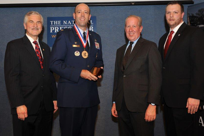 Standing (left to right): NSPE President Harve D. Hnatiuk, P.E., F.NSPE; Lt. Col. Patrick Miller, P.E., U.S. Air Force; Executive Director Mark J. Golden, FASAE, CAE; and NSPE Board Member David Scott Wolf, P.E., PLS, F.NSPE.